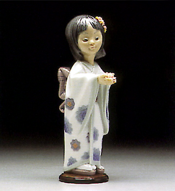 Bearing Flowers Lladro Figurine
