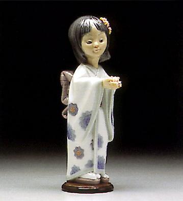 Bearing Flowers Lladro Figurine