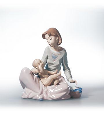 Dressing The Baby Lladro Figurine