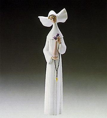 Serene Moment-white Lladro Figurine