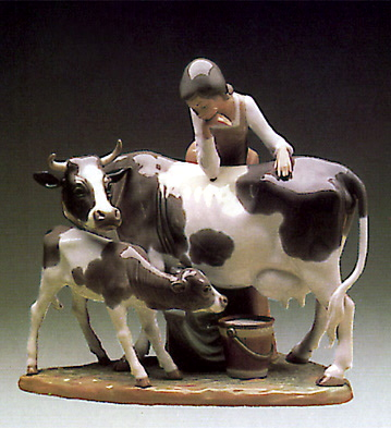 Woman With  Cow And Calf Lladro Figurine